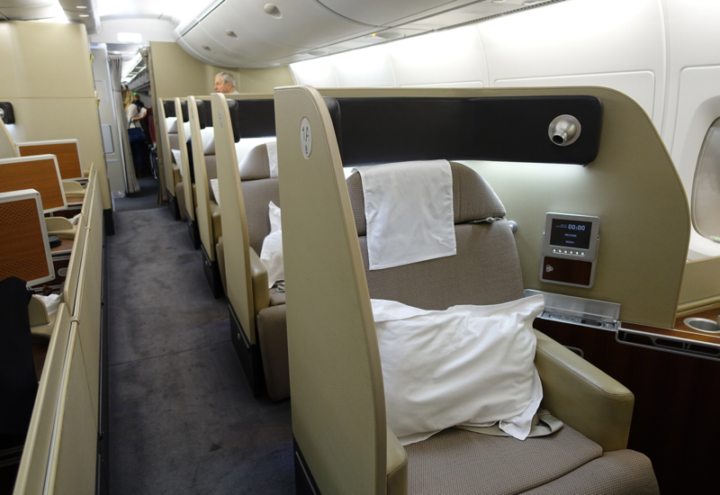 Ottoman in front of bed - Qantas First Class A380 Review Travelsort