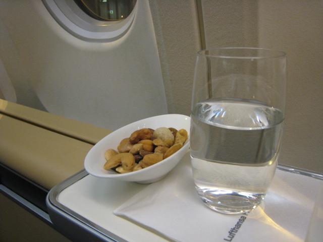 Lufthansa New First Class Review - Pre-flight drink and nuts