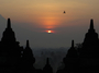 Square_borobudur_sunrise_tour-stupas_at_sunrise_with_bird