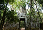Square_ta_prohm_jungle_temple_review-hidden_entrance_gate_with_heads