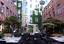 Square_review-katz_orange_berlin_restaurant_outdoor_seating_in_courtyard