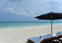 Square_rosewood_mayakoba_review-beach_and_lounge_chairs_umbrella