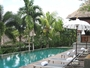 Square_kayana_seminyak_bali_review-main_pool_and_lounge_chairs