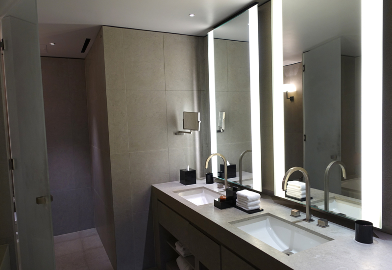 Armani Premier Suite Bathroom with Dual Vanities and His and Hers Sinks