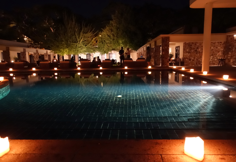 Amansara Pool Lit by Candlelight at Night