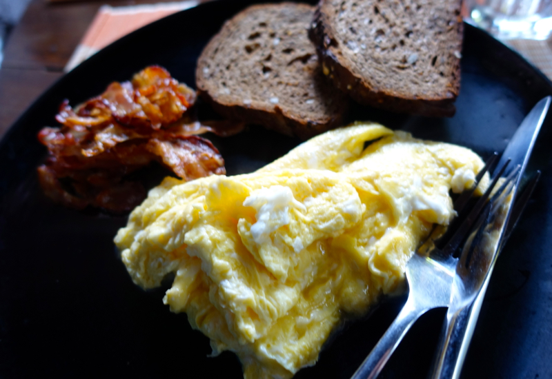 Scrambled Eggs and Bacon at Amansara's Khmer Village House