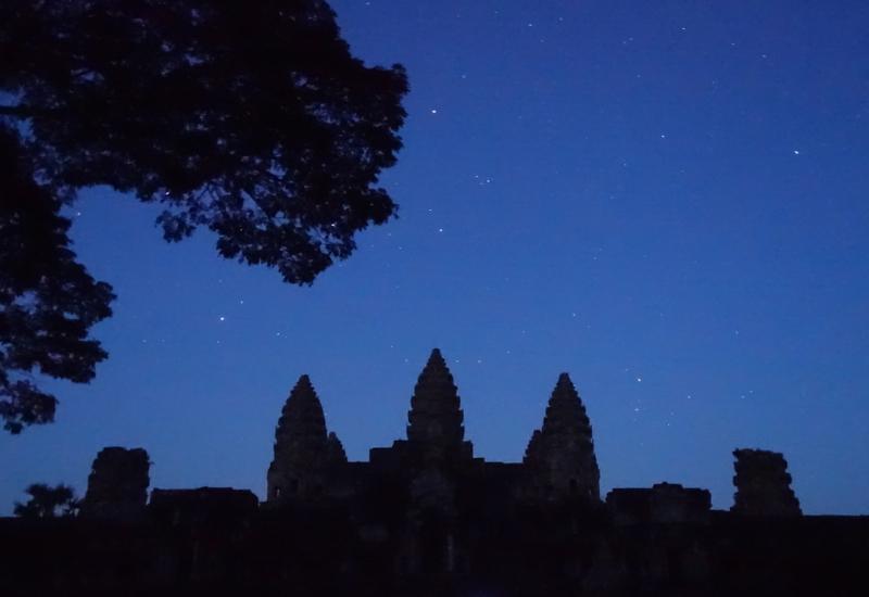 Angkor Wat at Night Under Starry Sky