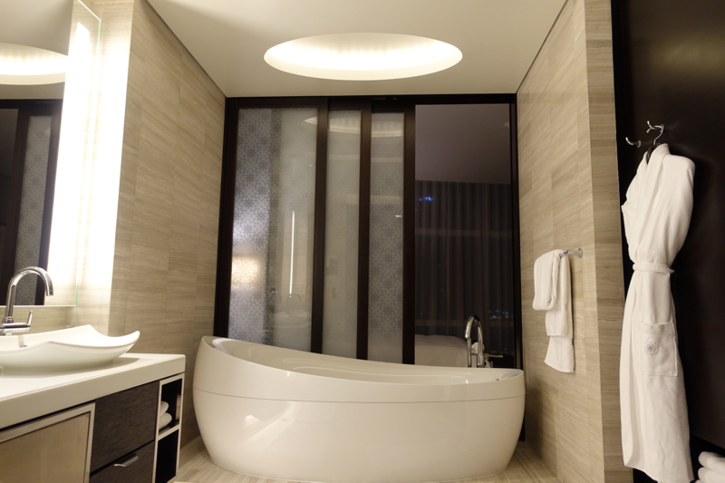Rosewood Abu Dhabi Review-Oversized Bath Tub and Sliding Glass Partition Between Bathroom and Bedroom