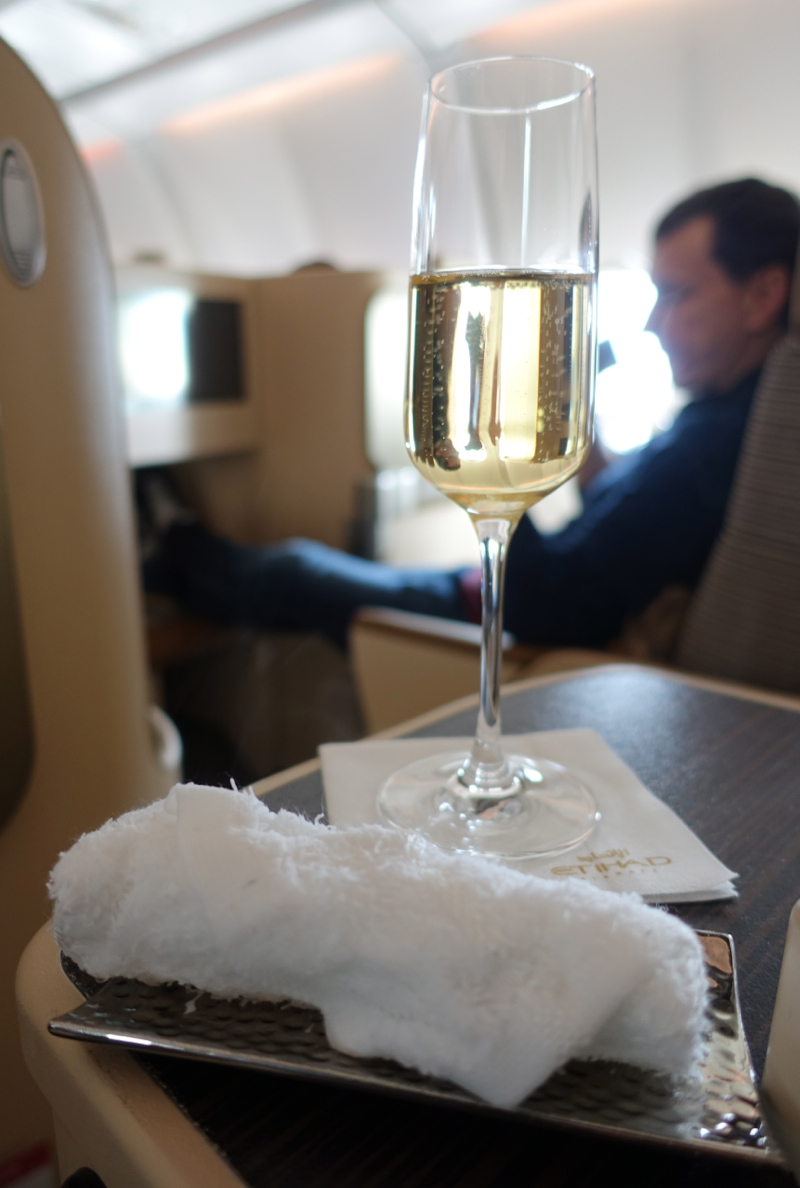 Etihad Business Class Review-Refreshing Towel and Pre-Flight Drink-Champagne