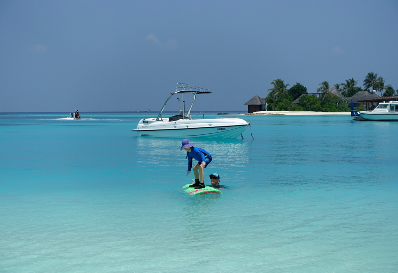 Surfing in the Maldives: Learning to Stand on the Surfboard