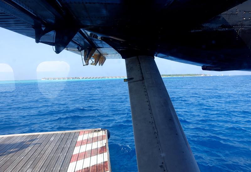 Trans Maldivian Seaplane Approaching a Buoy