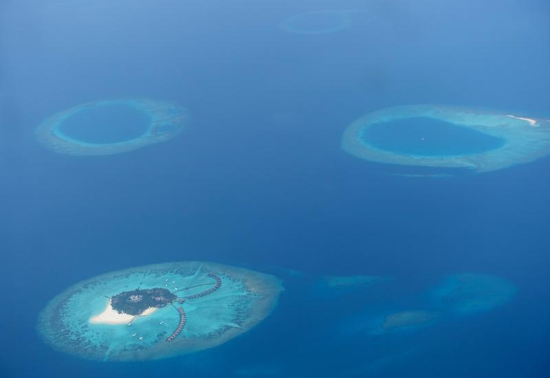 View of Atolls from Trans Maldivian Seaplane, Maldives