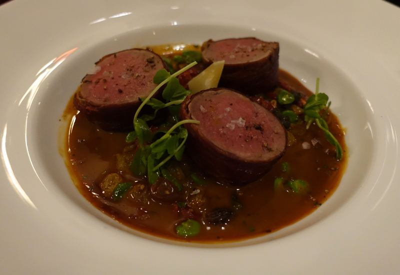 Serrano Wrapped Veal Fillet with Fava Bean Relish, Allium Four Seasons Chicago Review