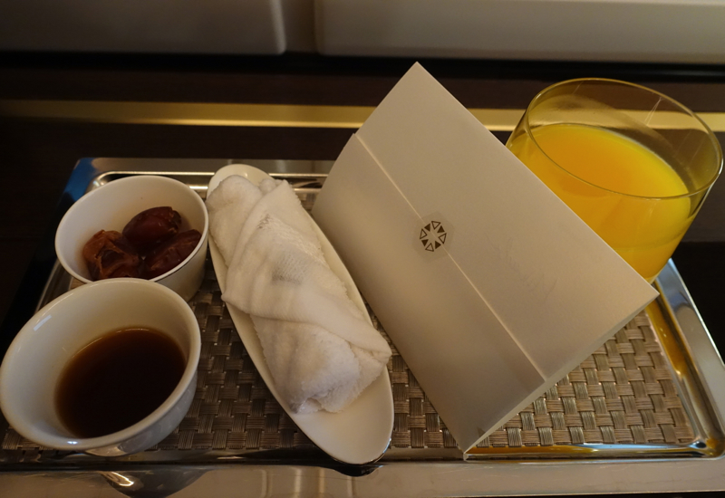 Etihad First Class Pre-Flight Arabic Coffee, Dates, Refreshing Towel