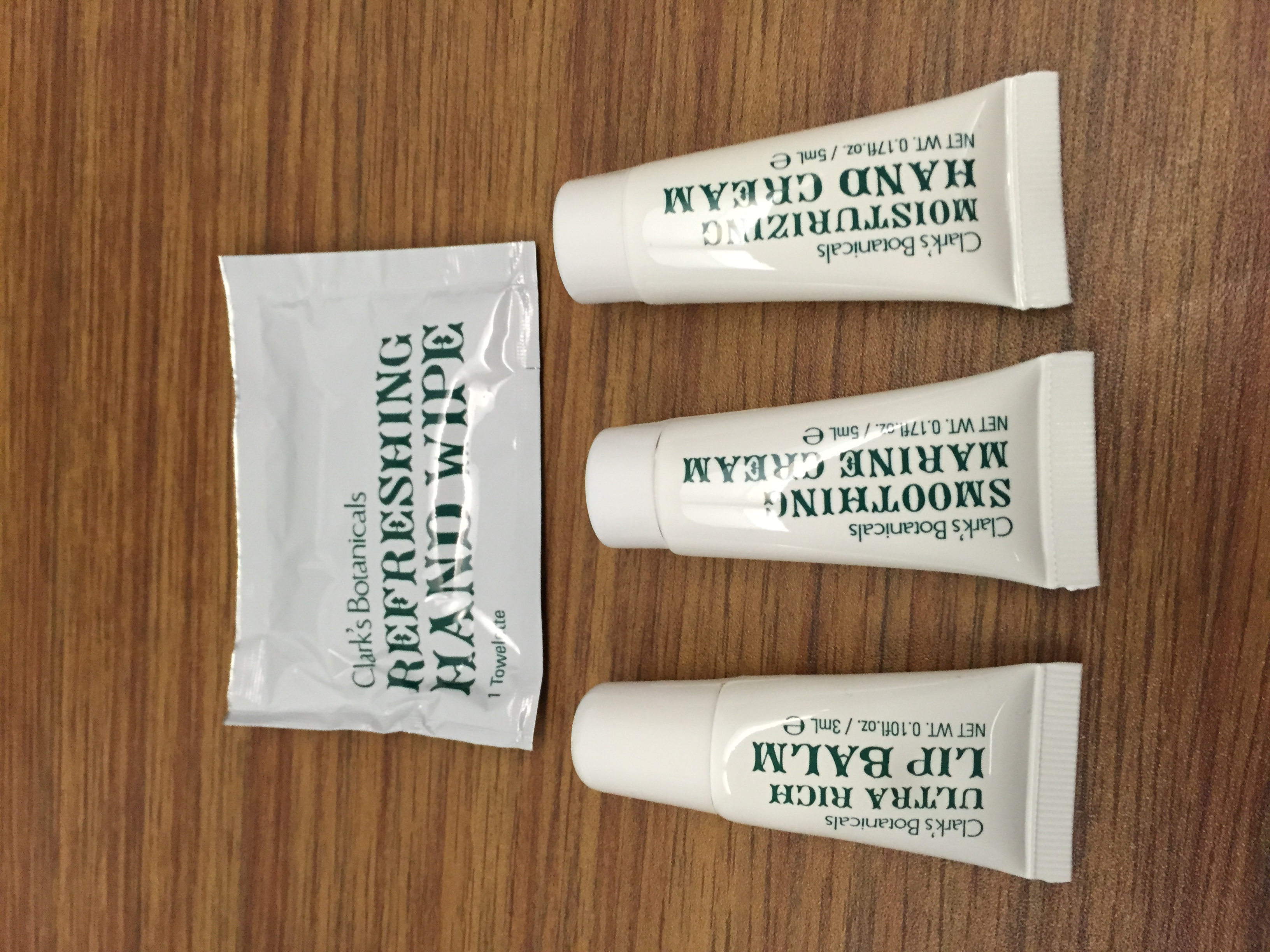 American A321 First Class Amenity Kit Review: Clark's Botanicals Moisturizer, Hand Cream and Lip Balm