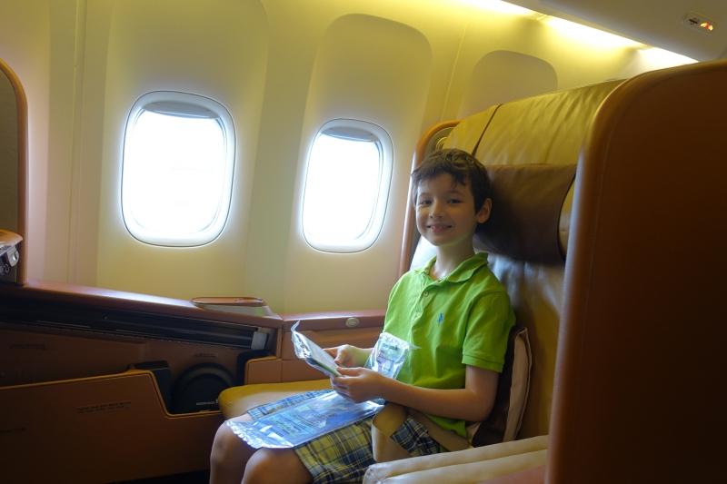 Enjoying Seat 1F, Singapore First Class Review, 777-300ER