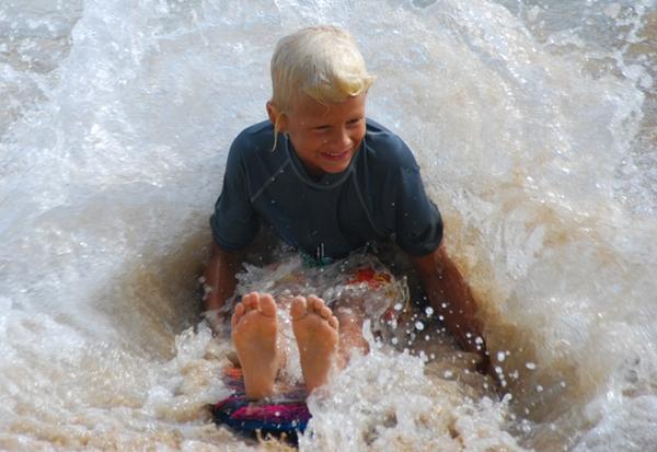 Kid playing in the water, Waikiki Beach, Hawaii