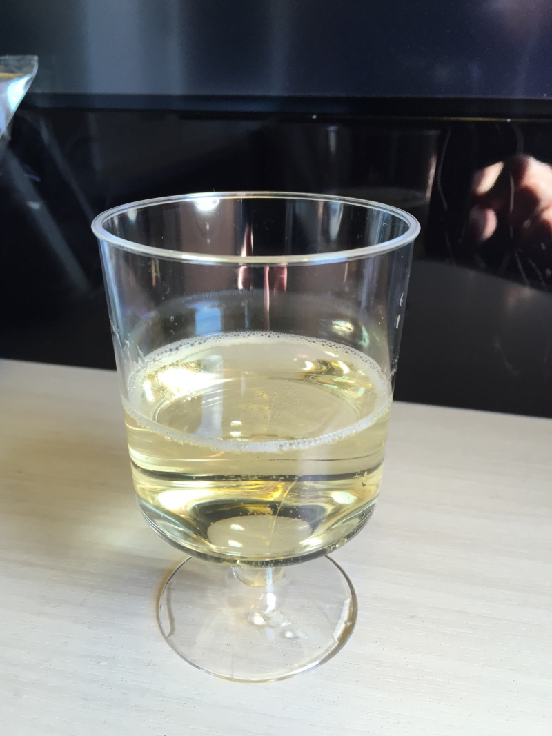 Pre-Flight Drink of Champagne, Japan Airlines Business Class Review