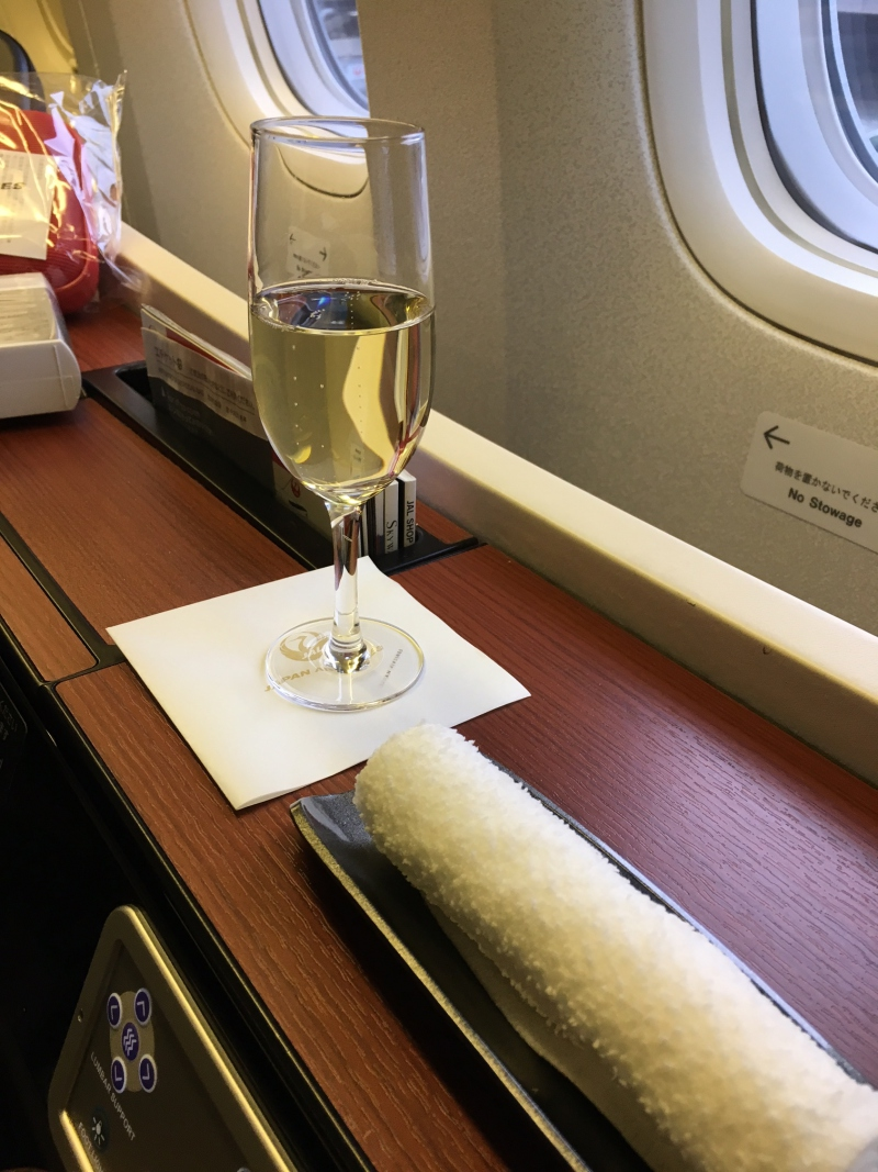JAL First Class Review-Champagne Pre-Flight Drink and Oshibori