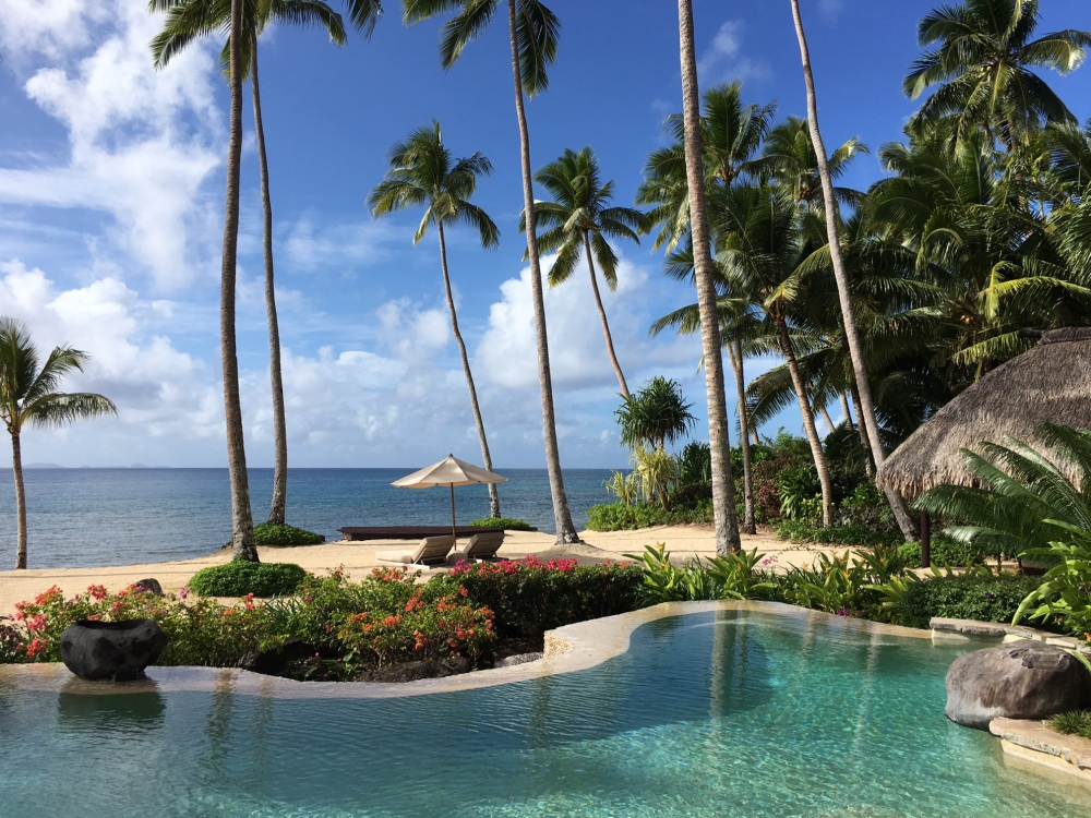 Laucala's Free Form Pool is Steps from the Beach