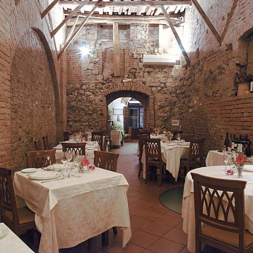 The stunning dining hall at Antica Osteria da Divo, Siena