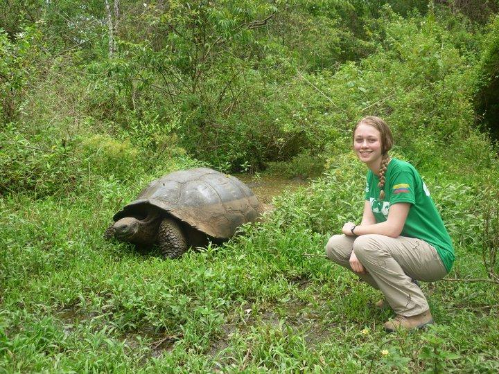 Lead volunteer next to the Galapagos namesake tortoise