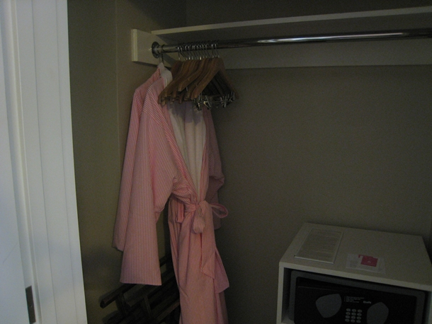The Royal Hawaiian Hotel Review-Closet with pink and white Frette robes