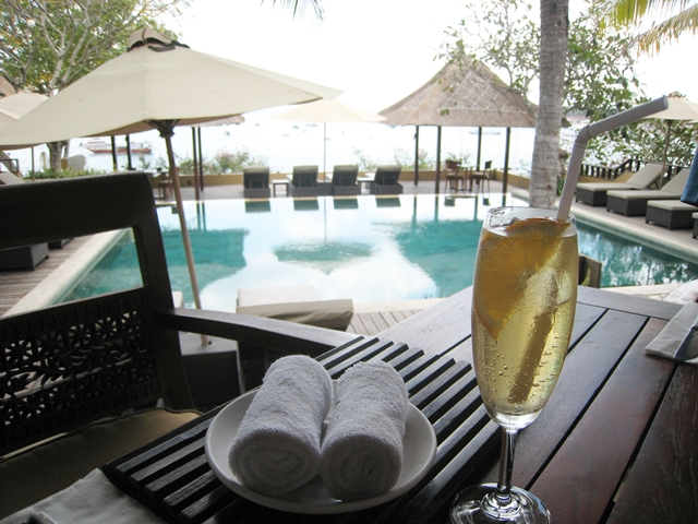 Batu Karang Review - Welcome drink and towel by pool