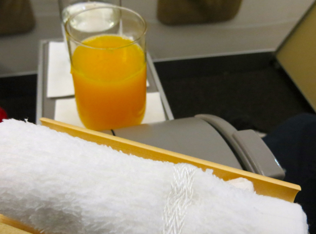 Etihad Business Class Review Male to Abu Dhabi - Cool Towel and Fresh Squeezed Orange Juice