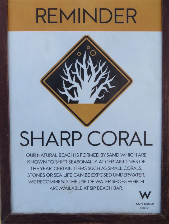 W Retreat Koh Samui: Sharp Coral and Coarse Sand on Beach