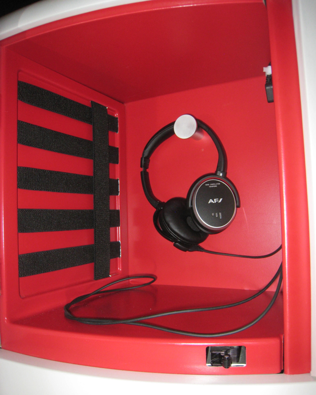 Air France New Business Class Storage Compartment and Headphones